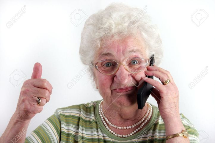 16193221-a-old-lady-using-a-mobile-phone.jpg
